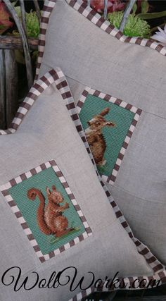 Salvaged Needlepoint Pillow Slips. #squirrelpillow #rabbitpillow