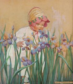 Little girl leans over to smell beautiful violet irises in a flower bed