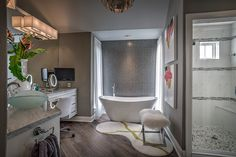 Designed by The Design Firm in Stafford, Texas #interiors #interiordesignideas #design #interiordesign #interiordesigners #bathroom #masterbath #bathtub #bathroomideas