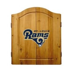 This NFL St. Louis Rams Wooden Dartboard Cabinet Set is made of solid  pine and makes a great gift for the sports fan in your life. This  officially licensed dartboard comes with mounting hardware and six team  logo darts.   Great gift for sports fan Perfect for man cave or garage Made by Imperial International Solid pine wood dartboard cabinet All natural 18-inch bristle dart board Mounting instructions and hardware included Six steel darts with team logo on flights Includes chalk and ...