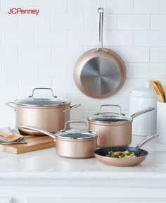 Tap to shop!// No kitchen is complete without a nonstick copper cookware set. This 8-piece collection from KitchenAid includes matching skillets, pots and pans with lids. Whether frying, sauteeing, simmering or boiling, you'll have everything you need to create a homecooked meal your family will love. Fade Resistant, Rust Resistant, Non-Stick, Induction Safe copper pots and pans.
