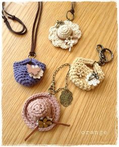 miniature crocheted bags and hats for accessory