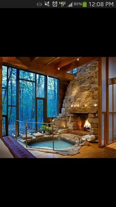 Cool hot tub and fire place... Oh wow glad a girl can dream!