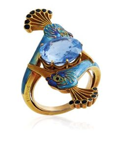 AN ART NOUVEAU SAPPHIRE AND ENAMEL RING, BY RENÉ LALIQUE Centering an oval-cut sapphire between two peacock heads applied with blue and black enamel, circa 1900; sold. CHF 162,500; 11/13/17.