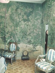 Pauline de Rothschild in her Paris apartment bedroom, decorated in 18th century chinoiserie wallpaper