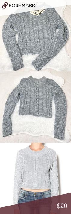 Knot grey cropped sweater Brand: Uniq Size: S/M Description: Knit grey and white cropped sweater with a ribbed round neckline. Condition: Excellent used condition. No rips or stains. Uniq Sweaters Crew & Scoop Necks
