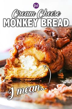 Monkey Bread with a cheesy, gooey little secret! Stuffing the dough with chunks of cream cheese makes a delicious treat. Prepare yourself to completely WOW guests with this sweet breakfast. Take your next batch of monkey bread to the next level. Savory Breakfast, Breakfast Items, Sweet Breakfast, Breakfast Recipes, Dessert Recipes, Cream Cheese Recipes, Cream Cheese Filling, Cream Cheese Monkey Bread, Desert Recipes