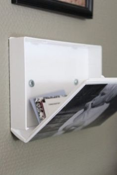A VHS case screwed into the wall provides unexpected hidden storage.
