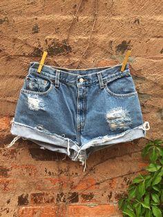 "Vintage LEVIS Cutoff Jean shorts Womens Denim Distressed Shorts Size 27"" on Etsy, $34.00"