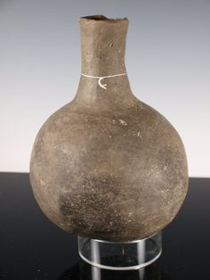 """Ancient Caddo Arkansas water bottle. Caddo plainware vessel. Denoted on bottom """"Caddo Troy Admire 1978 Ark. Area"""" Authentic ancient piece of Caddo pottery. 9.0 inches tall"""