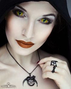 Mesmerized 👁️👁️ Model La Esmeralda wearing her 'Witchcraft' pendant, 'Familiar' and 'Coven' rings in black. Summon yours from www.trickery.com.au