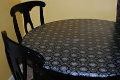 My kitchen table resurfaced and restyled using fabric, Mod Podge and a clear sealer.