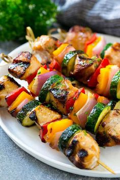 chicken kabob marinade A plate of grilled chicken kabobs made with marinated chicken and colorful vegetables. Chicken Kabob Recipes, Grilled Chicken Skewers, Grilled Fish Recipes, Steak Kabobs, Healthy Grilling Recipes, Skewer Recipes, Kebabs, Cooking Recipes, Sides For Grilled Chicken