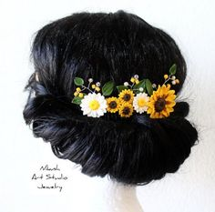 A beautiful sunflower comb made with a polymer clay flower. A unique comb for your special themed wedding, or for Spring and Summer wear. ... Flowers are made from polymer clay. Water resistant. The accessory can be made in any color on request. View matching accessories at: https://www.etsy.com/il-en/shop/NikushJewelryArt/search?search_query=Sunflower