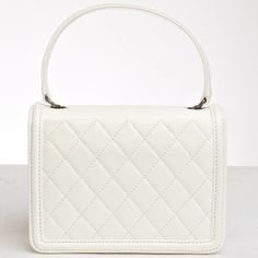 Chanel White Leather Boy Brick Bag - Never Carried | From a collection of rare vintage handbags and purses at http://www.1stdibs.com/fashion/accessories/handbags-purses/