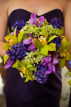 purple, lime and fuschia bouquet with dark purple gown.   This is my wedding look.