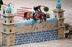 Seems to be 7 1/2 foot Puissance class. Anyone know what competition and who rider and horse combo is?. Awsome shot.