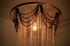 Wheel and Chain Chandelier by HartfordBicycle on Etsy Wheel Chandelier, Chandelier Lamp, Chandeliers, Cool Lighting, Lighting Design, Luminaria Diy, Light Project, Home And Deco, Lamp Shades