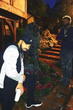 Drake wearing  Jordan Retro 4 Speckle Pull Over Hoodie, Jordan Jumpman Flex Fit Cap, Nike Jordan Varsity Sweatpants, Jordan PSNY x Air Jordan 12 Friends and Family
