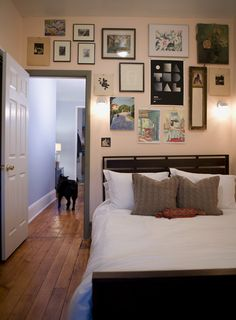 cozy bedroom with gallery wall