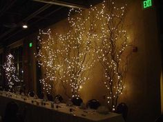wedding branches w/lights- maybe no lights on branches but uplighting- to fill white wall spaces