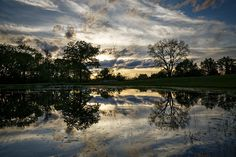 Clouds over a rural pond near Overton in Cooper County Missouri by Notley Hawkins Photography. Taken with a Canon EOS 5D Mark III camera with a Canon EF16-35mm f/4L IS USM lens at ƒ/8.0 with a 1/80 second exposure at ISO 100. Processed with Adobe Lightroom 5.7  and DXO OpticsPro 10.  http://www.notleyhawkins.com/
