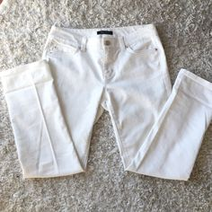 White House Black Market White Jeans White jeans in perfect condition. Size 4s (short) but I rolled them up as capris/cropped pants since I am a 4 regular and they fit great White House Black Market Jeans