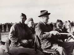 President Roosevelt during a visit to Sicily, December 1943, with Generals Clark and Patton in the rear seat.