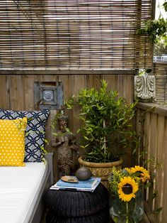 Small cushion area with pillows, ottomans and awesome yellows. Small Balcony Design
