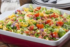 Grab your favorite 9x13 cake pan, and let's get to making a salad! Our Cake Pan Layered Salad is just like those layered salads you see in the fancy-looking glass bowls, but is even easier to make and take! And don't worry, we didn't skimp on any of