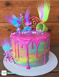 Rainbow drip troll cake by Sarah's Custom Creations