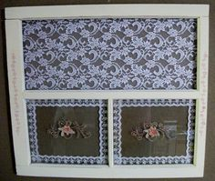 This is an antique window that had the top pane of glass missing. I painted it a flat ivory and stenciled it with a dusty rose in a distressed manner. Then I stretched lace over the top section with the missing glass and lace around the edges of the bottom windows behind the glass. I applied an applique found at a habby store to the glass in the window panes below. I love the way it came out. :-) Very fun DIY project for my Shabby Chic guest bedroom.