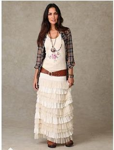 Long ruffled skirt with cowboy boots peeking out.  Flannel shirt?