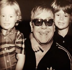 EJ and his sons playing in a photobooth (INSTGRM)