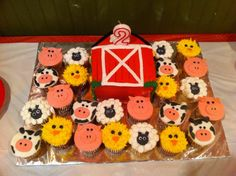 Barn birthday cake with farm animal cupcakes!