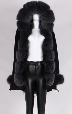This gorgeous gray fur trimmed fur lining black parka coat will keep you warm and ultra stylish. Luxury parka in classic black paired with a lush fox fur trimmed hood and fox fur lining is the perfect