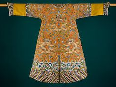 Festival Robe Period: Qing dynasty (1644–1911) Date: second half of the 18th century Culture: China Medium: Silk and metallic thread embroidery on silk satin Accession Number: 35.84.8