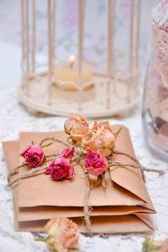 Beautiful dried roses, brown paper bag envelopes & raffia tie.