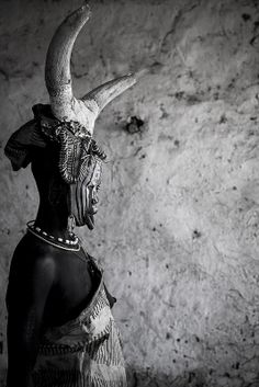 Mursi tribe woman with cow horns on the head, Mago park, Ethiopia
