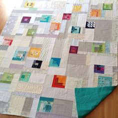 love this idea from Quirky Granola Girl. This would be so much fun using a lot of scraps from other quilts.
