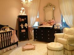 pink and creme paired with rich wood furniture makes a wonderful space for baby