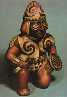 Arte Mochica. Estatuilla en terracota de un guerrero. El realismo, el adecuado empleo de los colores y la habilidad retratística (especialmente expresa en las vasijas-retrato), distinguen la producción cerámica mochica, la más variada y perfeccionada del Perú precolombino.