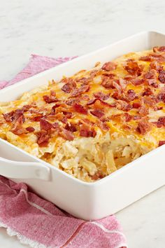 Loaded Shoestring Potato Bake – Layer ranch dressing, sour cream, shoestring potatoes, and more for this Loaded Shoestring Potato Casserole recipe. Top with everyone's favorite—bacon—for a winning holiday side dish idea.