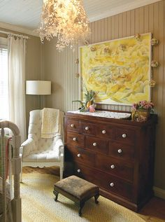 Lovely Baby's Room    Create a focal point with a handsome armoire.    Homeowner Sappho Griffin created a country theme in her daughter's bedroom with beadboard panelled walls and ceilings. Beautiful traditional furniture elevates the room while a floral laser-cut pendant lamp adds a touch of whimsy.