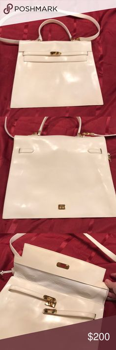 """Moschino shoulder and handbag vintage white 14.5"""" L X 11.5"""" H. Very thin/slender. Pretty, Vintage Moschino. Not NWT. I had used this, but it's in terrific shape. A few minor little marks. You could probably have outside shined up, but it's pretty as is. Very classy. It's white, but more a creamy white. Has the little lock (the lock has some scuffs) and the keys. Moschino Bags Shoulder Bags"""