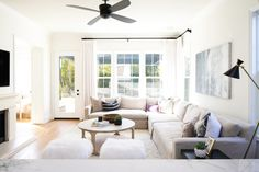 BECKI OWENS- Las Palmas Family Room. This breezy coastal bohemian family room uses Royal Oak Canewood Hardwoods, Benjamin Moore Chantilly Lace white paint, black ceiling fan and accents, linen slipcovered sofa, and vintage textiles.