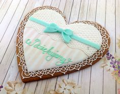 Cookie heart with lace, ribbon and greeting.