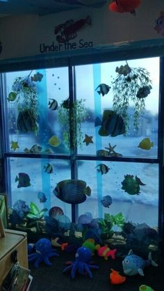 An Ocean Classroom in a Few Simple Steps. Ocean classrooms are one of the most peaceful themes. Here's how to create an ocean classroom in a few simple steps! Check out my favorite teacher resources to make your ocean classroom perfect for your kids. Preschool Classroom Decor, Classroom Themes, Ocean Themed Classroom, Classroom Window Decorations, Classroom Curtains, Classroom Door, Ocean Themes, Beach Themes, Underwater Theme