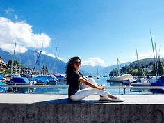Nestled between hills and vineyards and dominated by a magnificent castle, on Lake is an inviting destination for those visiting I loved this little town 😊. Wearing transfer top - travel light, discover more! Lake Thun, Travel Light, Switzerland, Vineyard, Castle, World, Building, Instagram Posts, Top