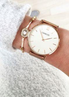 A minimalist mesh rose gold watch encompassing timeless, elegant design.